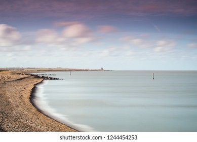 A long exposure Seascape of the view from Minnis Bay, Kent, UK to Reculver Towers on a windy November day.