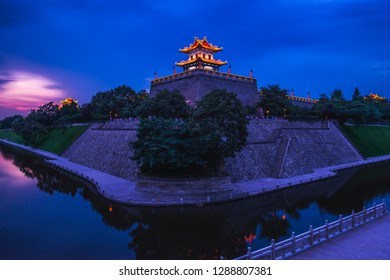Long exposure of the setting sun over the old city walls of Xian, China.