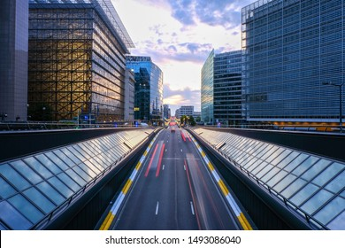 Long exposure shot from a bridge in Brussels. Traffic tunel and Europen headquarters in the foreground