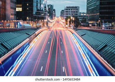 Long exposure shot from the bridge in Brussels, Belgium. Red traffic lights on the road