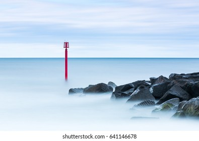 Long exposure shot of a channel marker buoy in Lyme Regis, England