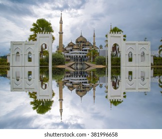 Long Exposure Shot of Crystal Mosque or Masjid Kristal in Kuala Terengganu, Terengganu, Malaysia, Asia during Cloudy Day with Full Reflection. Soft Focus and Motion Blur due to Long Exposure Shot