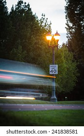 Long exposure shot of a fast moving car at dusk with a 40mph sign in the background in Stockton, CA.