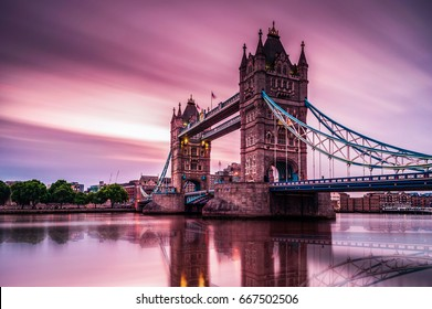 long exposure shot with fast moving clouds during sunrise Tower Bridge London, Sunrise clouds with reflection in the water thames river, Tower Bridge London England UK