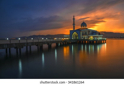 Long Exposure shot of Floating Mosque located at Penang Port, Butterworth, Pulau Pinang, Malaysia. Soft Focus, Motion blur due to long exposure shot. vibrant colors.