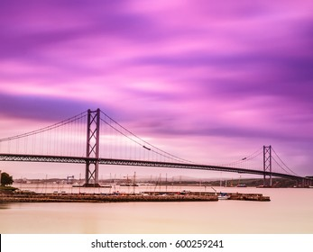 Long exposure shot of the Forth Road Bridge spanning over the Firth of Forth viewed from South-Queensferry. Scotland, UK