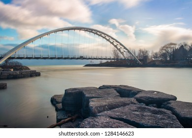 A long exposure shot of the Humber Bay Arch Bridge during sunset in Toronto Ontario