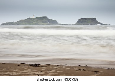 Long exposure shot of the island of Fidra and its lighthouse off the East Lothian coast in Scotland. Image was taken on a stormy day.
