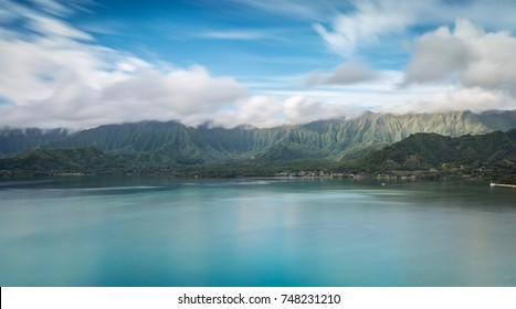 Long exposure shot of Kaneohe Bay with the Koolau Mountains in the background on Oahu, Hawaii