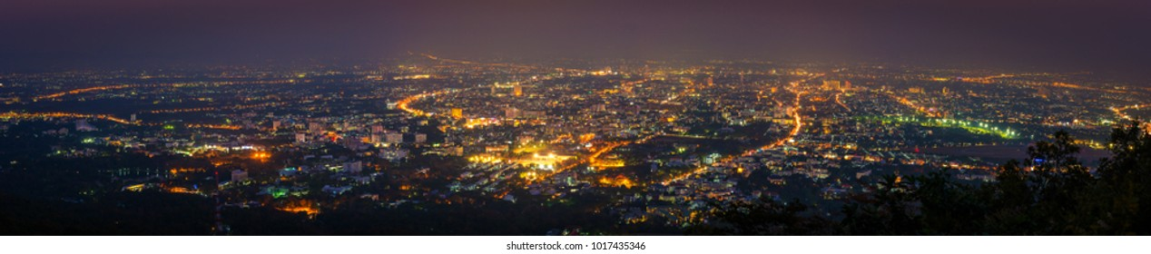 long exposure shot panorama image of Chiang Mai province,Thailand the old city  view from high angle spot night time.