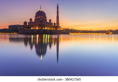 Long Exposure Shot of Putra Mosque (Masjid Putra) during Sunrise near Putrajaya Lake, Malaysia. Soft Focus and Motion Blur Due To Long Exposure Shot
