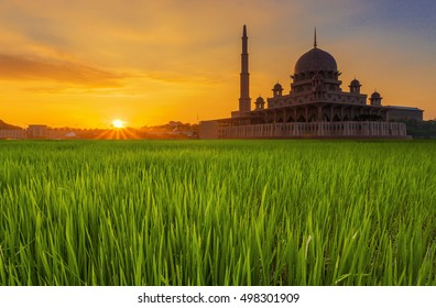 Long Exposure Shot of Putra Mosque (Masjid Putra) during Sunrise with Paddy Field, Malaysia. Soft Focus and Motion Blur Due To Long Exposure Shot