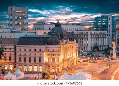 Long exposure shot of the Revolution Square, Victoria Avenue in Bucharest, Romania. Traffic and historical buildings (Panorama).