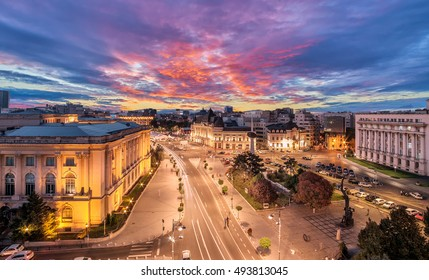 Long exposure shot of the Revolution Square near Victoria Avenue in Bucharest, Romania. Traffic and historical buildings.Bucuresti