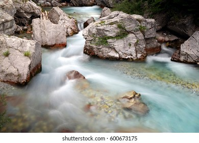 Long exposure shot of the river in Valbona, Tropoja, Albania. Grey rocks with light blue water.