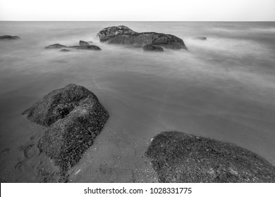Long exposure shot. Sea scape with stone beach at sunset, Motion blur, slow shutter speed.