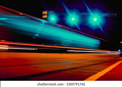 Long exposure shot of a truck passing at the signal green