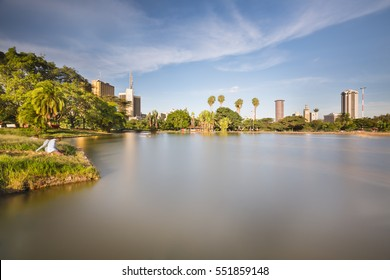Long exposure of the skyline of Nairobi, Kenya with the beautiful lake in Uhuru Park in the foreground.