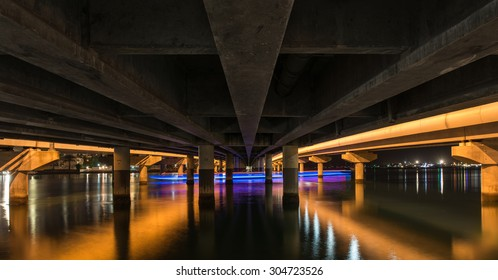 Long Exposure of the Southport Sundale Bridge from a Below Perspective With a Boat Creating a Neon Trail Light in the Canal, Gold Coast, Queensland, Australia