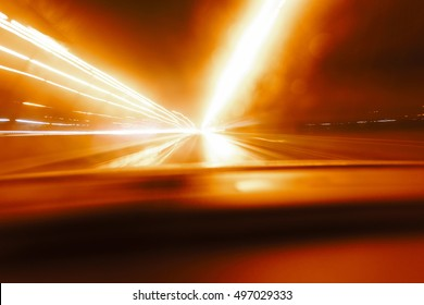 Long exposure speed car lights trails on a night highway.