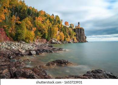 Long exposure of Split Rock Lighthouse complemented with fall colored trees and Lake Superior
