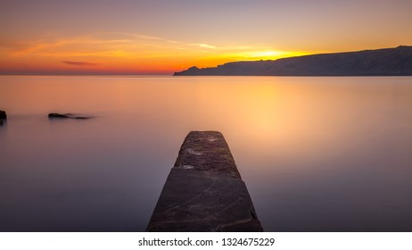 Long exposure of a stone jetty at Runswick Bay on the Yorkshire coast near Whitby