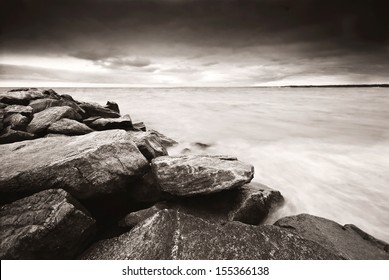 Long exposure. Stormy skies at Sunken Meadow. Black and white. Monochrome processed