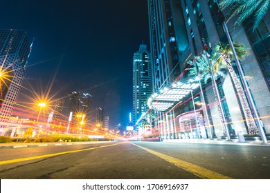 Long exposure of street at night with passing cars Dubai - UAE