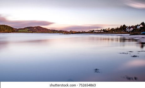 A long exposure with the sun behind the camera looking up the River Urr in Kippford, near Dalbeattie, Dumfriesshire. The sailing club jetty can be seen in the background