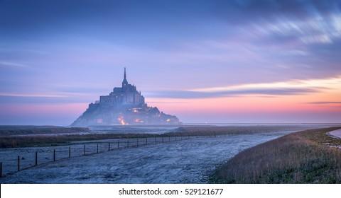 long exposure of sunrise at mont saint michel