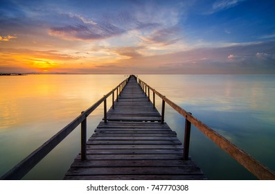 Long Exposure Sunrise Seascape with Abandon Jetty, Teluk Tempoyak, Pulau Pinang, Malaysia. Soft Focus & noise visible.