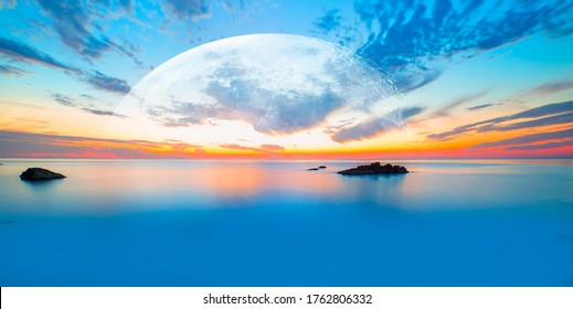 Long exposure of sunset at Alanya Beach, Alanya, Antalya - Long exposure image of Dramatic sky and seascape with rock and full moon