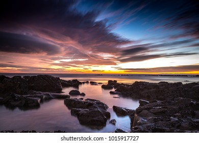 Long exposure of sunset landscape with clouds