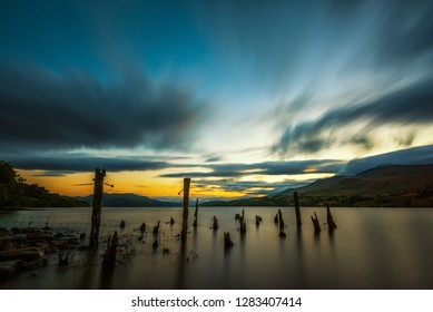 Long exposure sunset over Loch Tay in Highland Perthshire, Scotland
