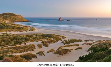 Long exposure sunset at Sandfly Bay beach, Dunedin, New Zealand