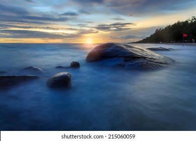 Long Exposure of Sunset at the sea,Larn hin khao , Rayong,Thailand , sunset at White rock beach , Rayong