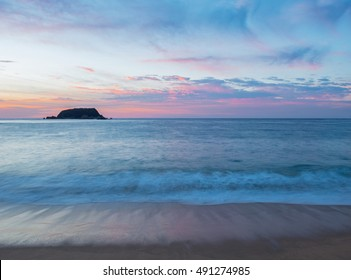 Long exposure of a sunset in Tangolunda Bay in Huatulco, Mexico.