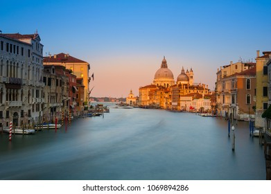 Long exposure sunset view of the Grand Canal and Basilica Santa Maria della Salute in Venice, Italy