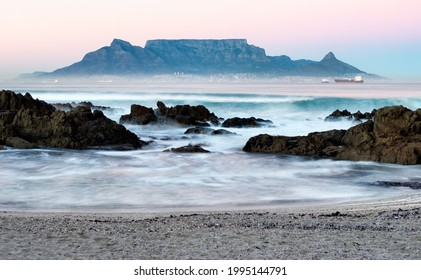 Long exposure of Table Mountain at twilight as viewed from Bloubergstrand beach in Cape Town, South Africa.