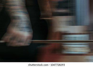 Long Exposure of Tattooed Man Playing Cello