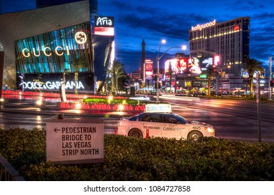 Long Exposure of a taxi cab at the intersection of Las Vegas Boulevard and West Aria Place in Las Vegas, Nevada, USA in May 2014