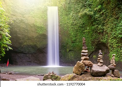 Long exposure Tibumana waterfall and stack of rock, Bangli, Bali Indonesia