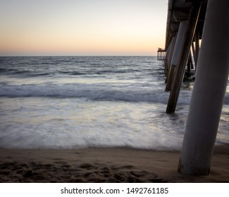 A long exposure of the tide rolling in under the Hermosa Beach Pier in California