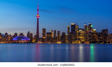 Long exposure of Toronto, Ontario - Canada. Bright sky with a smooth water surface. Beautiful city lights seen from the Toronto Island.