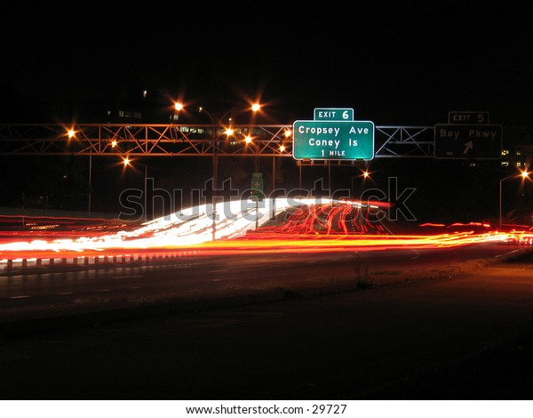 A long exposure of traffic at the Belt Parkway in Brooklyn, NY at night