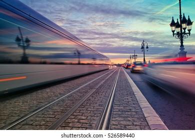 Long exposure of a tram passing on the Pont de Pierre stone bridge in Bordeaux, France