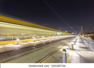 Long exposure of the tram passing over the bridge in Porto, Portugal