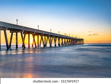Long Exposure ,View of sunrise at Johnnie Mercers Fishing Pier in Wrightsville Beach east of Wilmington,North Carolina,United State.