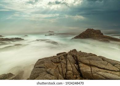 Long exposure water, beautiful seascape, ocean views, rocky coastline, sunlight, on the horizon. Composition of nature. Sunset scenery background. Cloudy sky. California coast. - Shutterstock ID 1924248470