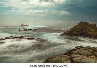 Long exposure water, beautiful seascape, ocean views, rocky coastline, sunlight, on the horizon. Composition of nature. Sunset scenery background. Cloudy sky. California coast. - Shutterstock ID 1927595498